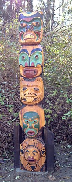 Eagle bear otter fish totem pole carving by chainsaw
