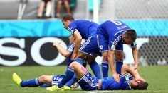 Muhamed Besic (R) and Toni Sunjic of Bosnia and Herzegovina are assisted by teammates
