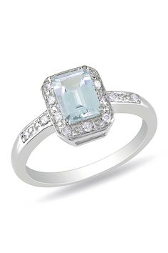 1ct Aquamarine, .06ct Diamond & Sterling Silver Ring... you can barely tell it's aquamarine though :(