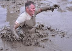 Col. John Keenan, deputy garrison commander, trudges through waist-deep mud at Sunday's Military Sprint Spartan Race at Fort Carson, Colo. Photo Credit: Wayne Barnett
