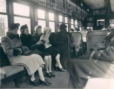 "On the 'L', 1943, Chicago. The accompanying caption read: ""Seldom crowded and always in the open, 'L' trains offer a..."