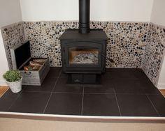 Modern Family Room Cottage Design - wood burning stove surround