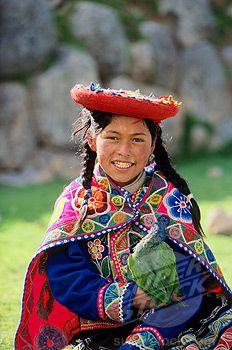 Portrait of a Quechua Indian girl smiling, Sacsayhuaman (Incan), Peru
