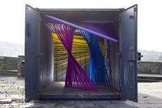 An array of ribbon colours for Cornwall Design Exhibtion within the shipping container