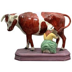 Large Figure of Cow and Milk Maid with a Pink Luster Base ($9,360) Staffordshire Pottery, England (circa 1820)