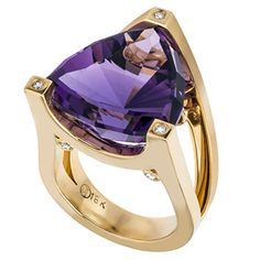 18kt yellow gold ring featuring a triangular shape amethyst that is prong mounted.  There are brilliant diamond rounds bezel set at each prong and under th