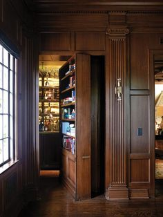 """A Look Inside Media Moghul Shane Smith's Santa Monica Estate - A bookcase in the library opens to reveal a speakeasy bar—one of Smith's favorite spots in the house, which he's dubbed """"the drinking room. Speakeasy Decor, Library Bar, Whiskey Room, Cigar Room, Hidden Rooms, Home Libraries, Secret Rooms, House Entrance, Home Office Design"""