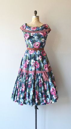 Vintage 1950s cotton dress with bold and jewel-toned watercolor floral dress with wide neckline, fitted bodice and waist, gathered pleat skirt with