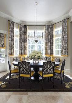 Yellow And Gray Dining Room Features Bay Window Dressed In Short Curtains Made