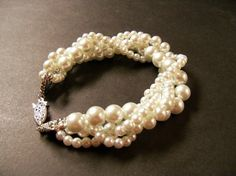 Twisted pearl bracelet Ivory glass pearl multi by Sabtisdesigns, $27.00