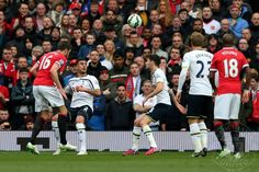 Michael Carrick (L) of Manchester United scores his team's second goal with a header during the Barclays Premier League match between Manchester United and Tottenham Hotspur at Old Trafford on March 15, 2015 in Manchester, England