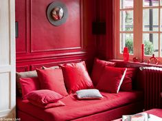 Submerge your senses in this completely red living room
