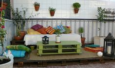 I like the idea of using a painted pallet as a coffee table. They have one at the local coffee shop.