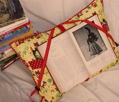 Reading Pillow Pattern: Inspired by my grandma's well-loved reading pillow, this pattern adds some funky and useful twists, such as handmade piping, a built-in book mark, page holders, and pockets for your reading glasses and pencils.