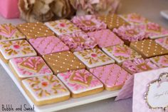 """Linda [Bubble & Sweet] says """"Royal cookies were an assortment of cookies in gold, pink and white that were a little bit more mature than the cookies we generally make for the kids parties. My little girl is growing up and the treats while still fun are more reflective of her tastes. They are fondant covered sugar cookies decorated with rolled fondant, royal icing and edible jelly jewels."""