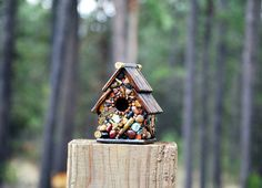 birdhouse for him Recycled Bullet Shell Birdhouse for Hunters from Oregon mosaic birdhouse man cave decor guns firearms outdoor decor by WinestoneBirdhouses. Explore more products on http://WinestoneBirdhouses.etsy.com