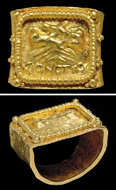 "A ROMAN GOLD MARRIAGE RING   CIRCA 3RD CENTURY A.D.   The broad flat hoop faceted, the rectangular bezel with two clasped hands (dextrarum iunctio) in repoussé above a Greek inscription reading, OMONOIA, ""harmony,"" framed by a beaded ring with clusters of granulation along the outer edges  7/8 in. (2.2 cm.) wide; ring size 5½"