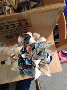 First attempt at one of my centerpieces. Paper flowers made out of maps and sheet music. Fabric quills for roses. Picture is property of Jessica A. Reese