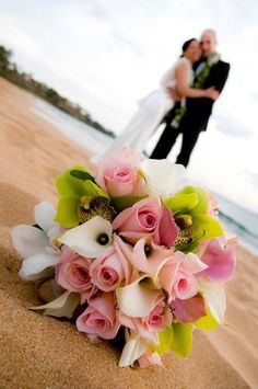 Tropical bridal bouquet with roses and orchids