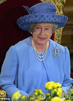 Britain's Queen Elizabeth II smiles while attending a lunch at Guildhall in London to celebrate her Golden Jubilee