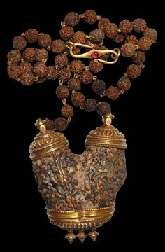 View Rare Shiva-Parvati Double Rudraksha Necklace with Ruby-Inset Gold Mounts - This extremely rare pendant necklace features a large double, binary or co-joined rudraksha seed. Double rudraksha seeds are rare. Examples this size are rarer still. Shiva Linga, Shiva Shakti, Om Namah Shivaya, India Jewelry, Ethnic Jewelry, Royal Jewelry, Antique Necklace, Antique Jewelry, Shiva Wallpaper