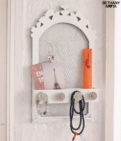 Jewelry Rack -  I just use my Jewelry Rack to keep everything neat and organized! It's shaped like an ornate mirror and features a mesh backing to hang your earrings, while a row of decorative knobs is perfect for displaying necklaces. It's perf for any gal with tons of jewelry like me!