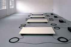 Wellenwanne is conceived as a model or test arrangement. flat trays are filled with water, each resting on four loudspeakers, which transmit the sound compositions via vibrations onto the water surface. the various sound pieces, which are partly inaudible, vary for each tray so that the sound signals generate various changing interference patterns.