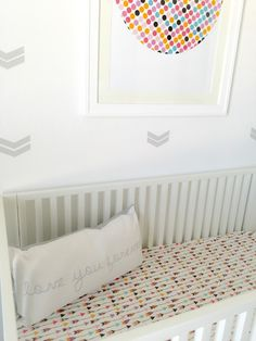 Colorful Arrow Crib Sheet in a Modern Aztec Nursery