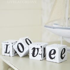 Inexpensive and cute wedding table decor idea - any message you want to create could go on these blocks