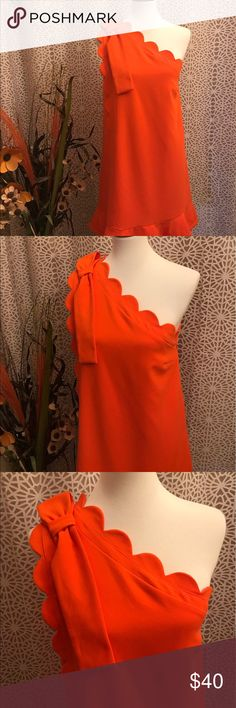 Bright Orange Scalloped Neck Bow Detail Dress Looks practically new! Zips up the side. Features a bright orange hue, one shoulder scalloped neck with bow detail and a unique hem. 63% polyester, 30% rayon, 7% spandex. Lining is 100% polyester. Victoria Beckham for Target Dresses One Shoulder