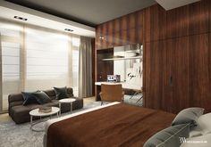 Projekt sypialni z zabudową z orzecha włoskiego wykończoną politurą, w tle kanapa Tufty Time firmy B&B Italia