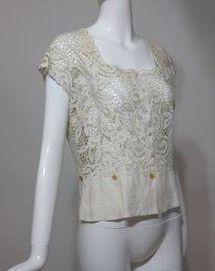 Madeira handmade cut work lace embroidered blouse in off white 1950s | From a collection of rare vintage blouses at https://www.1stdibs.com/fashion/clothing/blouses/