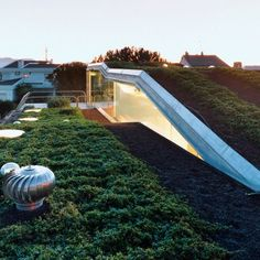 Villa Bio: Location: Barcelona, Spain Year of Construction: 2003 Architects: Enric Ruiz-Geli  Alternating planes frame the green roof and inform the multi leveled conditioned volume within.