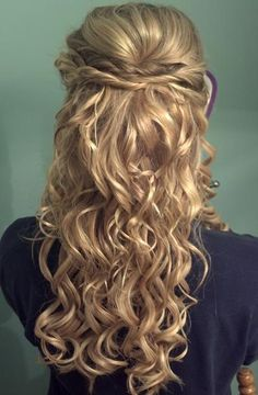 Twists hold this half-up hairstyle with  curls