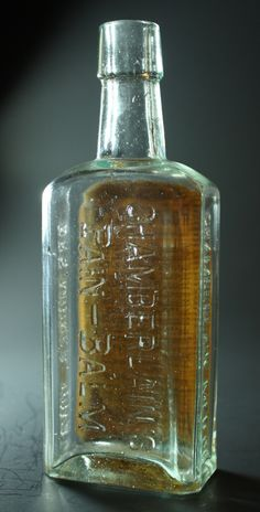 Chamberlain's Pain-Balm - Aqua, molded tapered lip, rectangular, 6 1/2in (167mm) tall. Embossing: CHAMBERLAIN'S PAIN-BALM (on back), CHAMBERLAIN MED. CO (on side), DES MOINES, IOWA (on other), Label (on front) - c1890 Old Medicine Bottles, Old Glass Bottles, Antique Bottles, Vintage Bottles, Perfume Bottles, Glass Collection, Apothecary, Cobalt Blue, Iowa