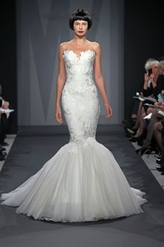 Needs a belt/sash to break up the design, but the silhouette is beautiful!  Mark Zunino 2014 Wedding Dress