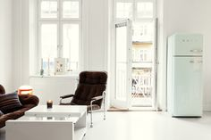 Fantastic Frank is a Swedish real estate agency... with stunning pictures of white homes...