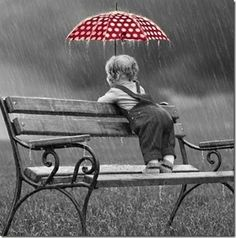 A .... RED! & white polka dot ...Umbrella! ... in the rain!