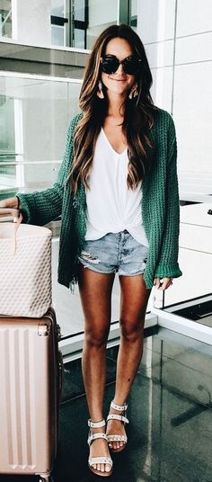 Cozy green cardigan over white tee and distressed denim shorts.