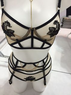 This striking set by Edge O Beyond is crafted of nearly transparent mesh with strong linear elements and playful embroidery