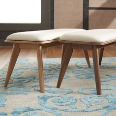 Woven textured seats, rounded off tapered legs, and comfortable clean lines accent this blast to the past style.