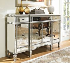 """60"""" Mirrored reflection Andrea hall console cabinet Model DH-695. Silver base color-tone with light brushed lining. Half Shelves compartments; ample storage space. Interior measurement behind middle doors: 29""""W x 13""""D x 19""""H. Interior measurement behind side doors: 14""""W x 12""""D x 19""""H. - No assembling required."""