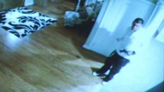 Footage taken from cameras in Aaron Hernandez's own home show the former Patriots player holding what appears to be a gun.