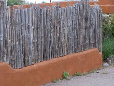 "Traditional New Mexico ""Coyote Fence"" Form meets function. Backyard Fences, Backyard Landscaping, Claremont House, Log Fence, New Mexico Santa Fe, New Mexico Style, Adobe House, New Mexican, Land Of Enchantment"