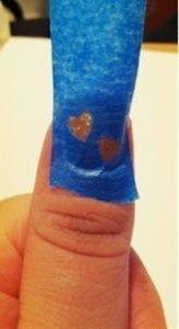 Punch holes in masking tape and paint over it on your nails! So simple!!