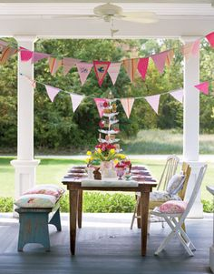 Brighten outdoor seating with cushions in vibrant prints, and capture spring breezes with banners cut from fabric. #easter #decorating