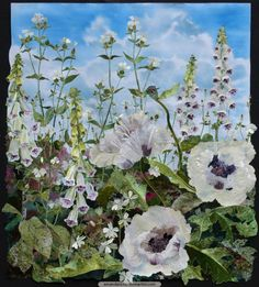 A celebration of summer, this textile collage is full of light. Having grown the stunning white foxgloves 'Pam's Choice', it was very satisfying to bring them into the studio and work from the tall stems of white flowers with aubergine markings. For these intricate patterns I have hand-dyed fabrics, both satin and velvet, slightly varying the markings for each flower.