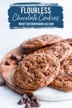 Simple Flourless Chocolate Cookies from What the Fork are naturally gluten free cookies that satisfy cravings for chocolate and chocolate chip cookies! They're so easy to make and call for just 6 ingredients with no special baking equipment required! You won't need much more than a bowl, a spoon, and a baking sheet! These cookies are made with egg whites so they're also lower in fat than traditional cookies. This recipe is mouth-watering and great for kids and adults!