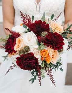 Visions of warm Autumn colors, fun pumpkin accents and rich details filled this fall wedding in Tennessee. The beautiful designs featured some breathtaking seasonal, fluffy blooms. The chosen color palette featured vivid burgundy coupled with gray, peach