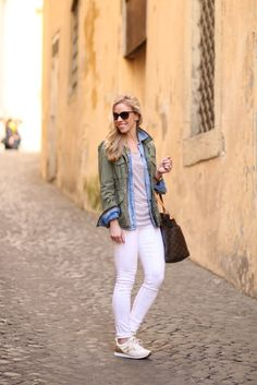 Off the Beaten Path: olive green utility jacket layered over open denim shirt and striped tee, Adriano Goldschmied white legging ankle jeans, gold and white New Balance sneakers, Louis Vuitton Totally MM tote, layered spring outfit